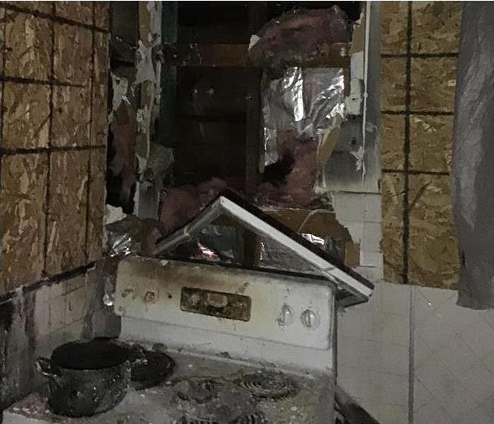fire damaged kitchen with extensive smoke and soot damages