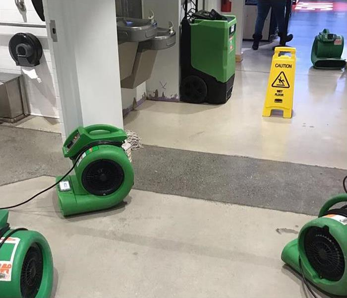 wet retail property with air movers and drying equipment for cleanup